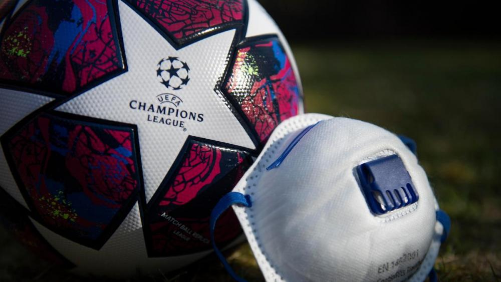uefa_champions_league_matchball_and_protective_face_mask.jpg